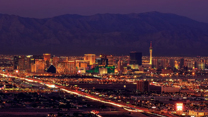 An image of the Las Vegas strip with mountains in the background.