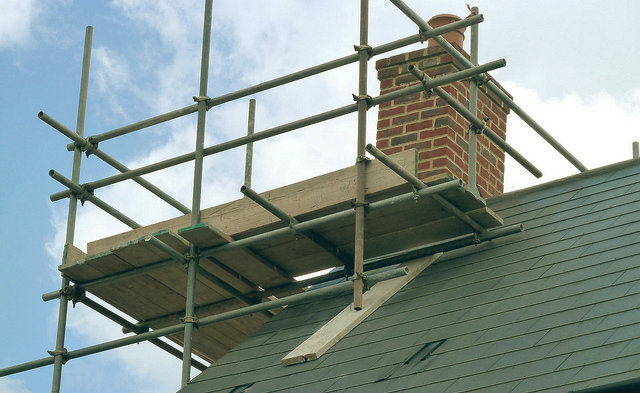 An image of scaffolding being placed on a property renovation